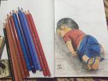 """بالفيديو والصورة .. الطفل السوري الغريق بأنامل التشكيلية """" هاجر القريمط """""""