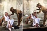 شاهد صورة رجل أمن يسقي حاجًا مسنًا في مكة المكرمة